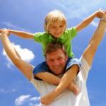 boy on man's shoulders