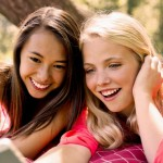 2 girls wearing with teeth straightened with Invisalign